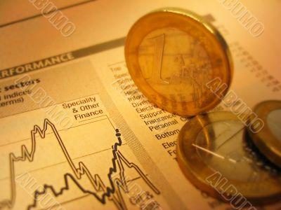 Fianacial chart and coins