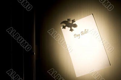 Post-it on fridge that spells pay bills nightmare
