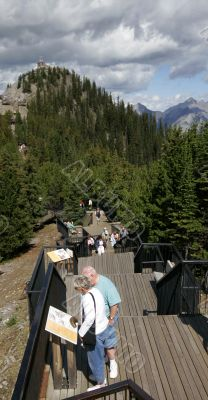 Retired Couple Reads Trail Information - Banff