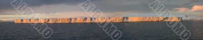 Tabular iceberg, sunset glow