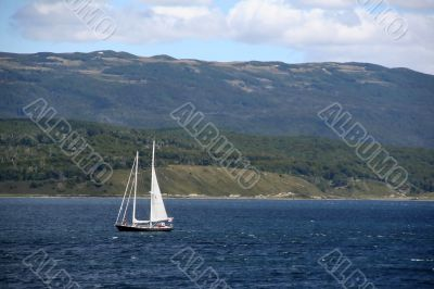 Sailboat in deceptively calm waters