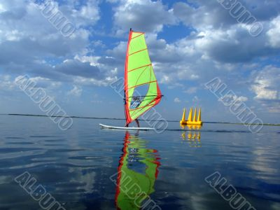 Windsurfer and its reflection in water of a gulf