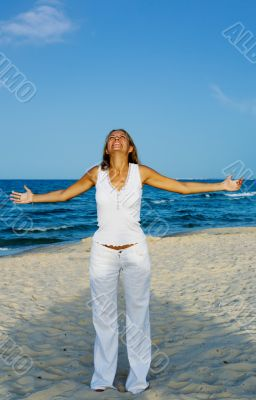 Young woman Relaxation exercise on beach