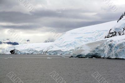 Overcast, glaciers falling into the sea