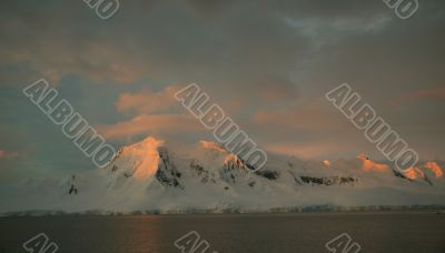 Sunset highlights on steep mountain ridges