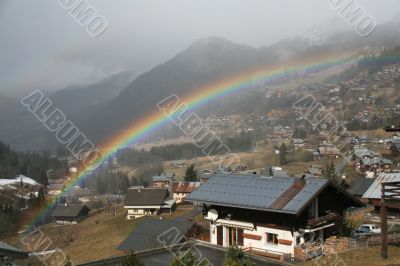Rainbow across alpine village