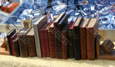Piles of old books for sale