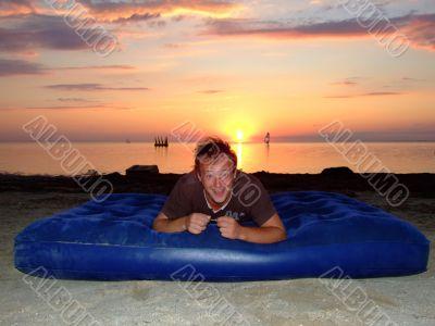 The joyful guy on a mattress