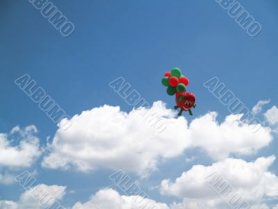sky with white clouds and balloons in background