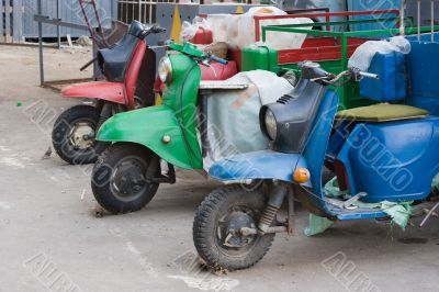 Three transport scooters