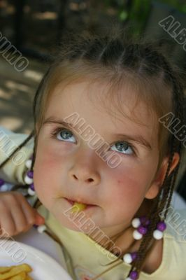 Girl eating french potato