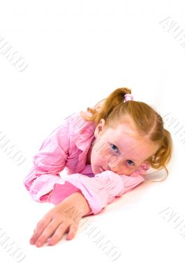 young girl laying on floor