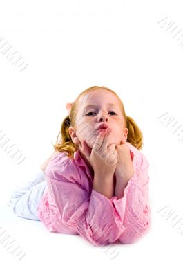 young girl is blowing a kiss