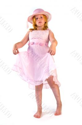 girl standing in pink dress