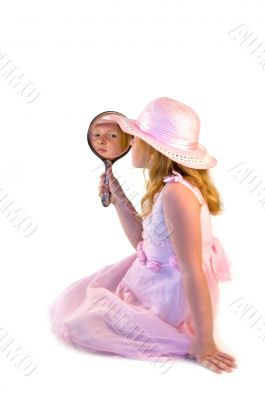 young girl holding a mirror