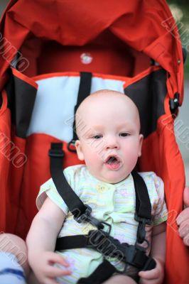 Baby in sitting stroller #2