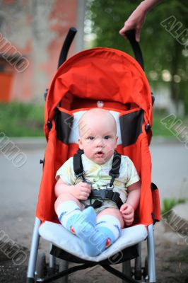 Baby in sitting stroller #5