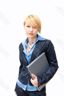 Businesswoman holding laptop under one`s arm