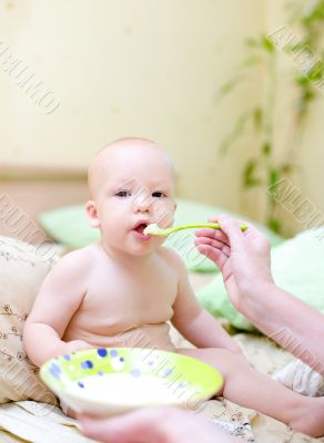 Mother feed baby by porridge #2