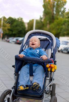 Smiling baby in sitting stroller #12
