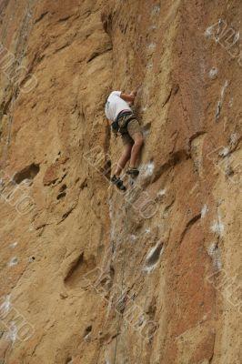 Climber on sheer rock face