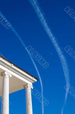 white columns over blue sky background