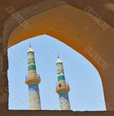 two minarets in an ancient city of Yazd, Iran