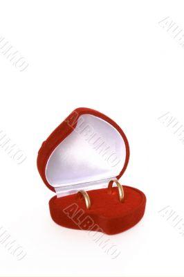 Wedding rings in red heart shaped velvet box