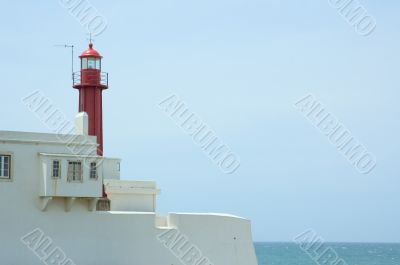 lighthouse over blue sky background with copyspace