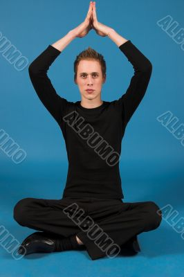 Portrait of a caucasian man in a yoga position