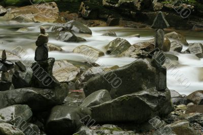 Rock Cairns Stacked Along River