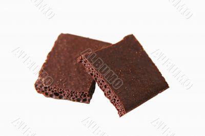 Blocks of porous chocolate isolated on white