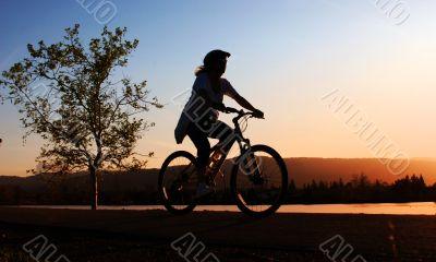 Woman riding her bike