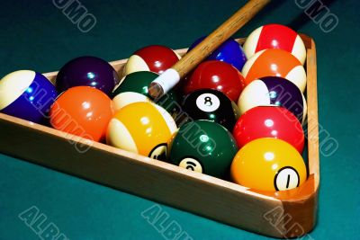 Racked pool balls, and a cue stick