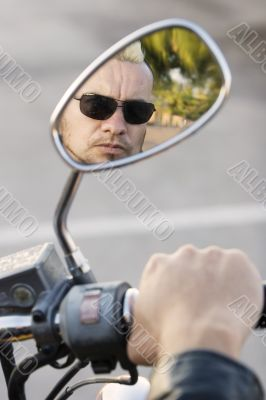 Punk in Motorcycle Rearview Mirror