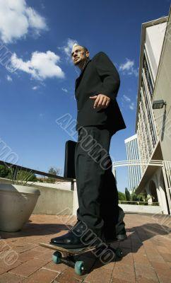 Punk Businessman on Skateboard