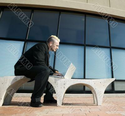 Punk Businessman on Laptop Computer