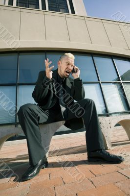 Frustrated Punk Businessman on his Cell Phone