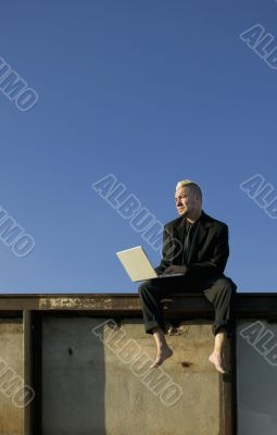 Barefoot Punk Businessman with Laptop Computer