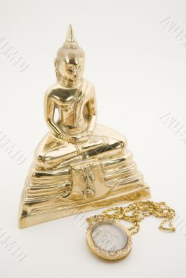 The sitting Buddha and a good luck amulet