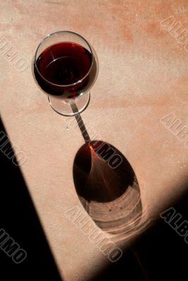 Wine Glass with Dramatic Shadow