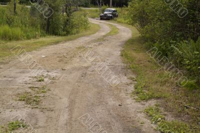 car on dirt road