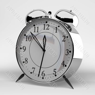 Metallic alarm clock on grey background