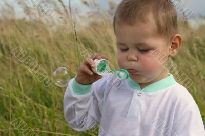 Baby with soap bubble