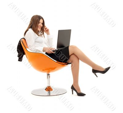 businesswoman with laptop in orange chair #2
