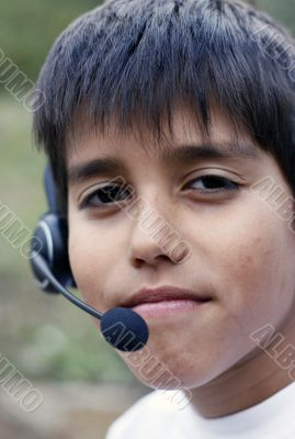 Young boy with phone headset