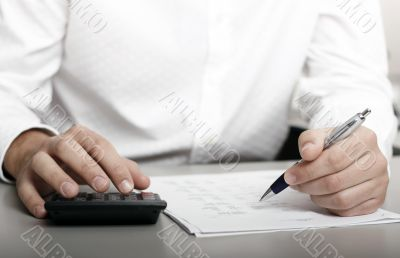 businessman calculating expenses at tax time