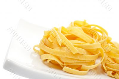 Uncooked pasta nest on a dish