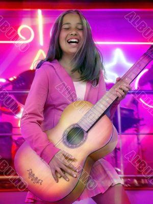 Happy teen girl with guitar