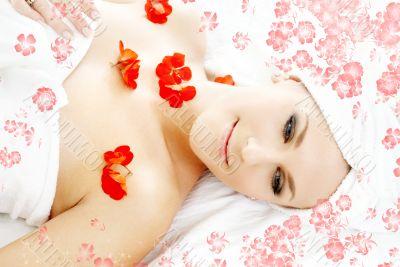red flower petals spa with flowers